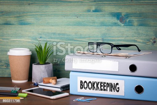 istock bookkeeping concept. Binders on desk in the office. Business background 893311798
