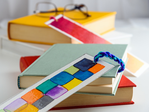 colorful bookmark on a closed green book. education. reading.
