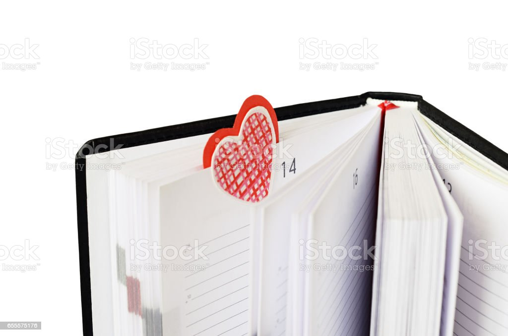 Bookmark in a notebook for Valentine's Day - foto de acervo