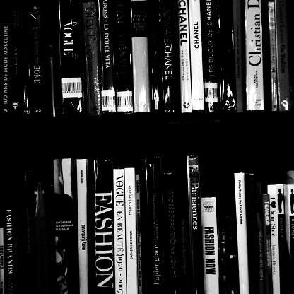 Paris. France - August 22, 2013: A Collection of books about fashion on the shelves of bookstores in Paris. Mobile B&W photo
