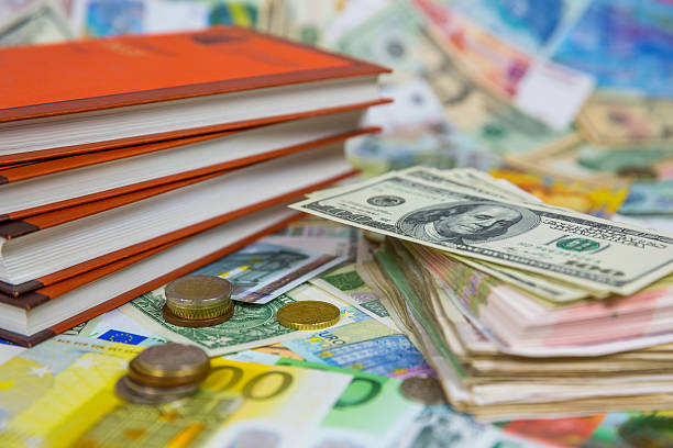 Books and a bundle of money stock photo