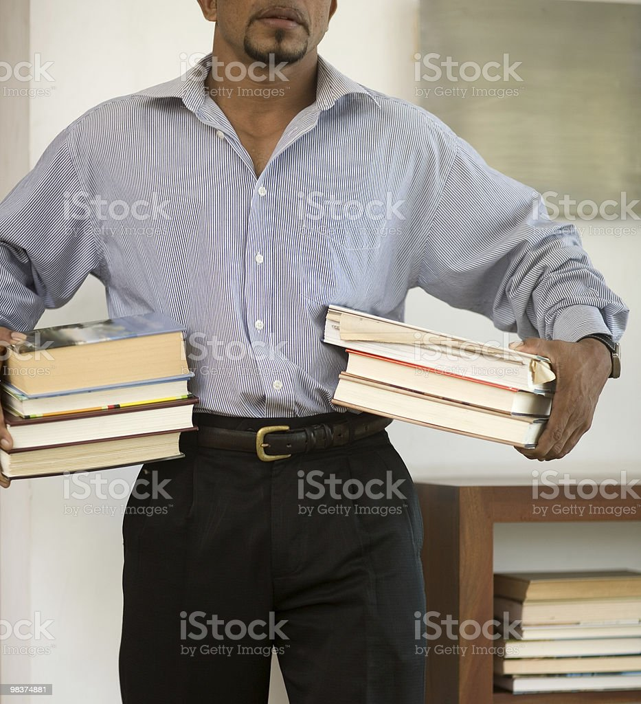 books and able bodied man carrying them royalty-free stock photo
