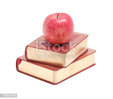 453684295istockphoto Books and Apple isolated on white background 180807260