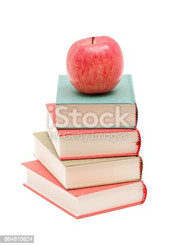 453684295istockphoto Books and Apple isolated on white background 864815624
