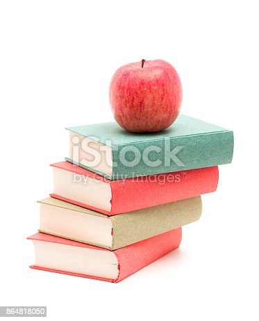 453684295istockphoto Books and Apple isolated on white background 864818050