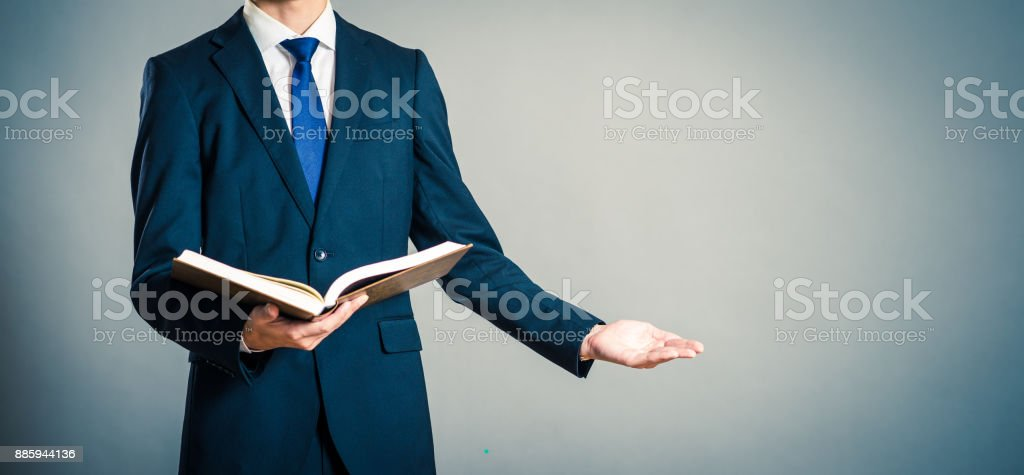 Books and businessmen stock photo
