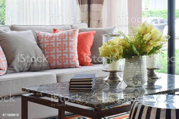 Books and decorative items on marble top table and lively sofa set picture id671968816?b=1&k=6&m=671968816&s=612x612&h=604fagis2f gpi6llqihd e 7zdztkpbf9damhdnxla=