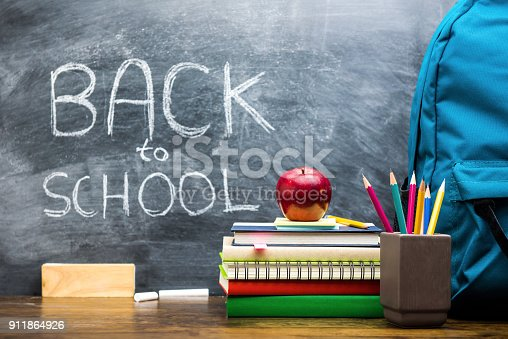 istock Books and education supplies on wooden table, back to school concept 911864926