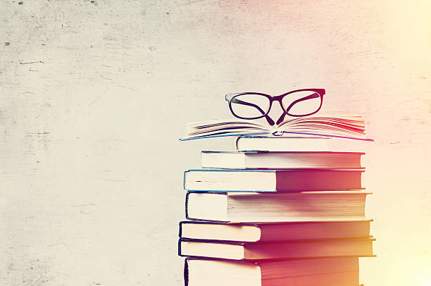 books and eyeglasses - literature stock pictures, royalty-free photos & images