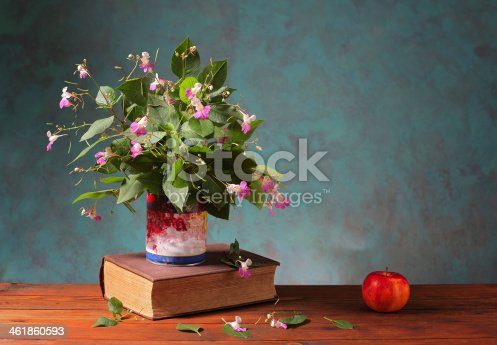 istock Books and flowers 461860593