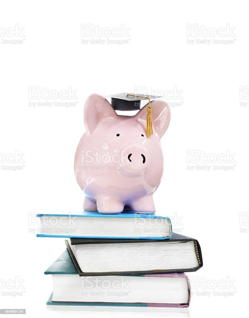 books and graduation piggy bank stock photo