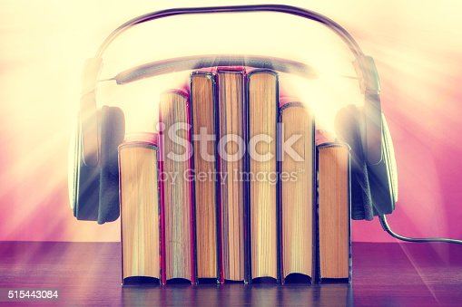 istock Books and headphones as an audiobook concept on wooden table 515443084