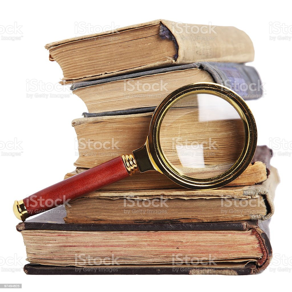 Books and magnifying glass isolated on white royalty-free stock photo