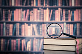 istock Books and magnifying glass 519427336