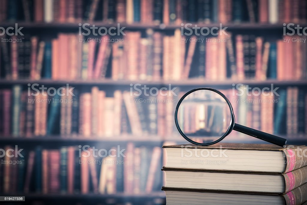 Books and magnifying glass bildbanksfoto