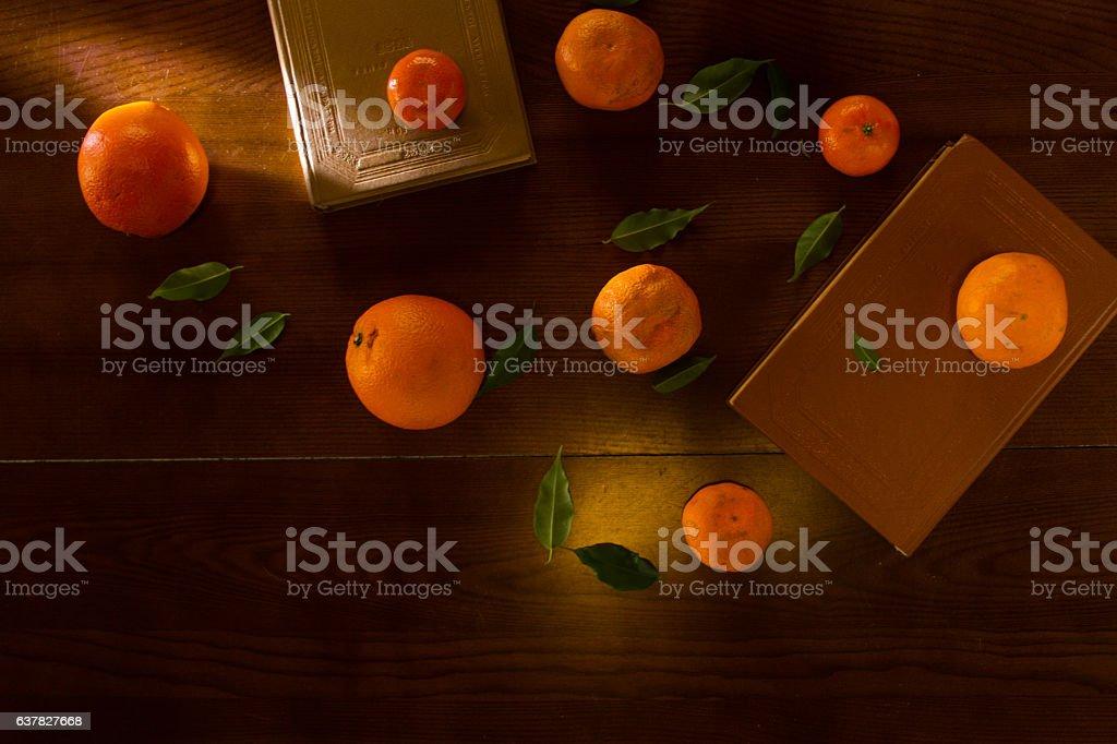 Books and oranges stock photo