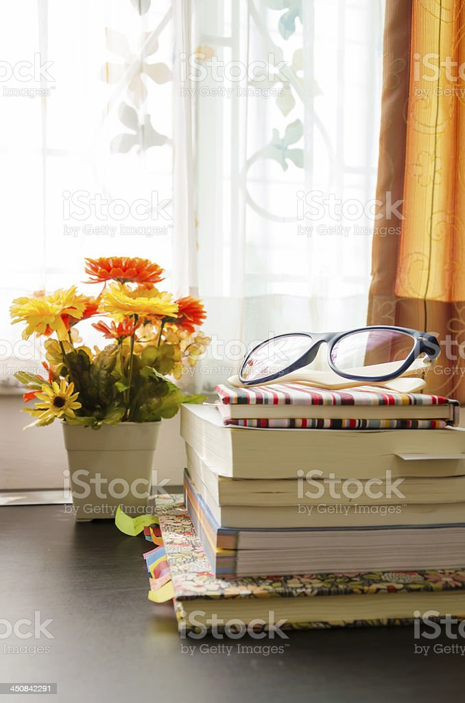 books and the glasses, near windows. royalty-free stock photo