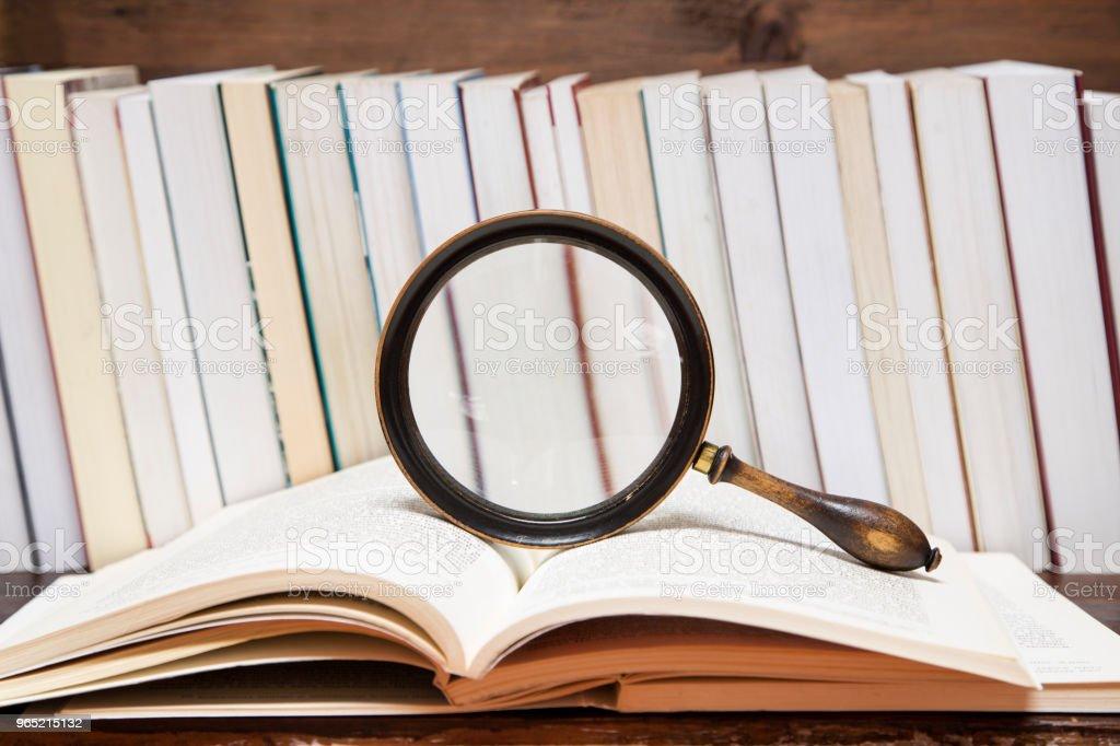 Books and the magnifying glass zbiór zdjęć royalty-free