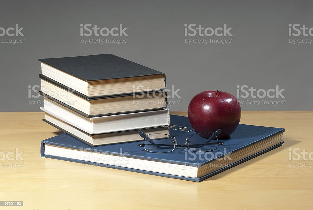 Books, Apple and Reading Glasses royalty-free stock photo