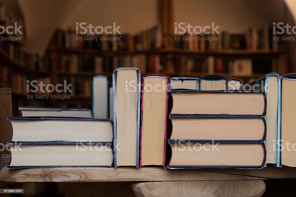 Books back on wooden shelves of store close up stock photo