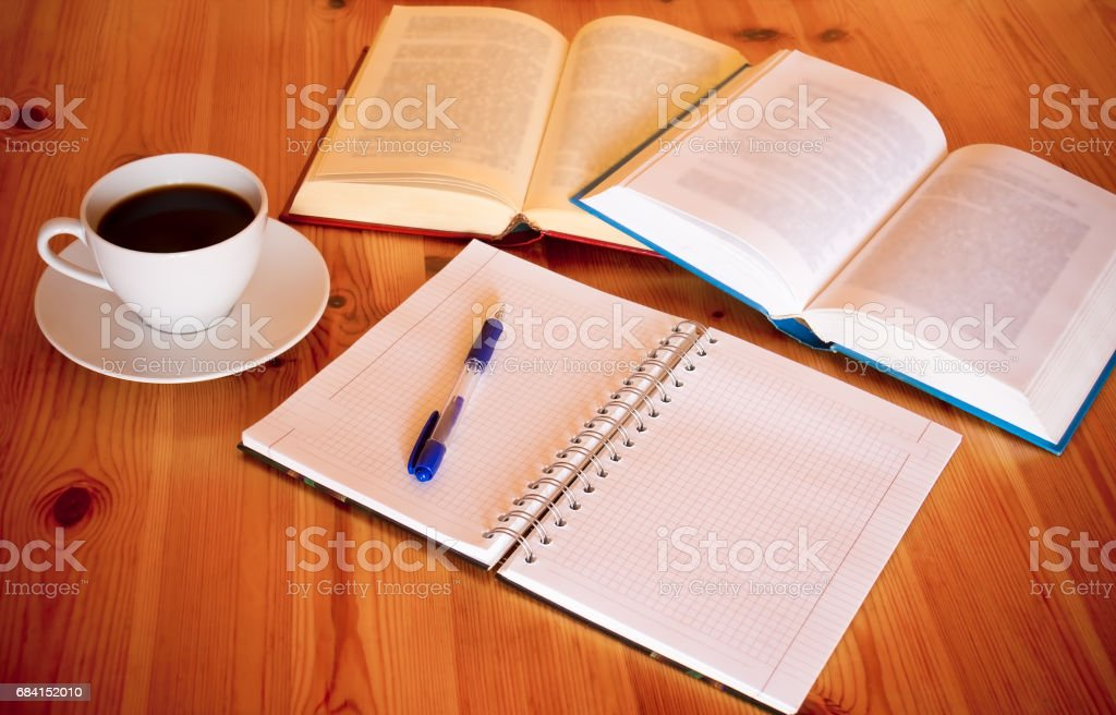 Books, blank  notebook, pen and cup of coffee foto stock royalty-free