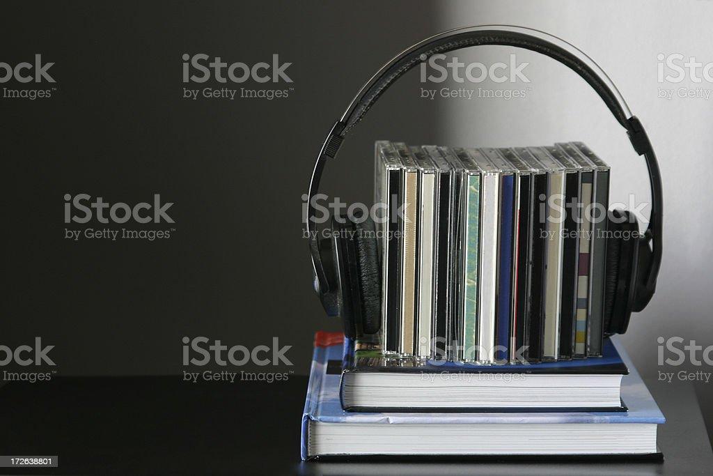 Books, cds and headphones arrangement stock photo