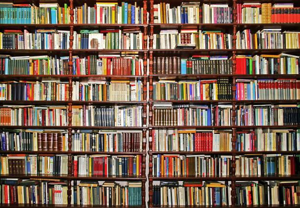 colección de libros - library fotografías e imágenes de stock