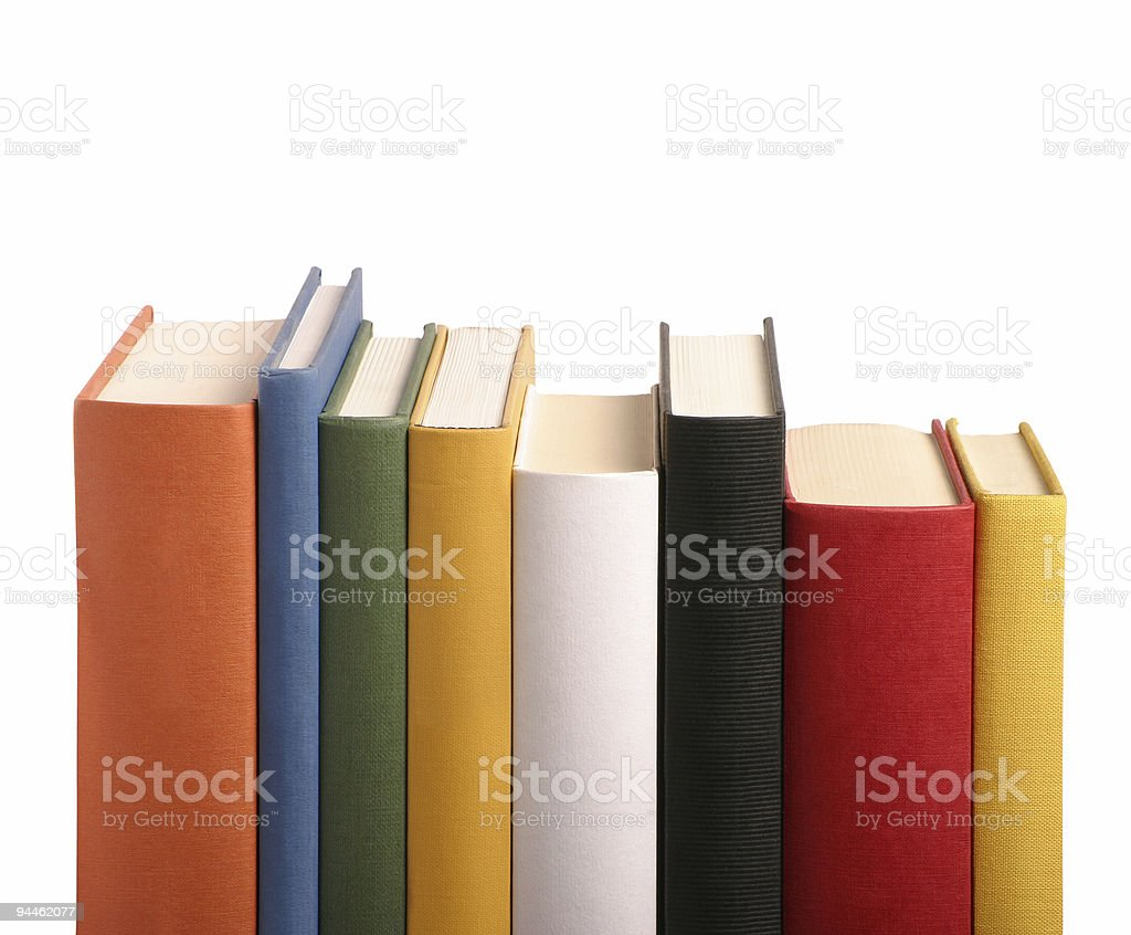 Books different colours in a row stock photo