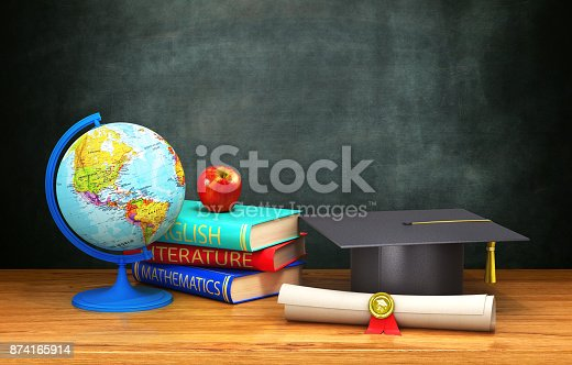 istock books, globe, diploma, apple, academic cap lie on a wooden table on the background of the board. 874165914