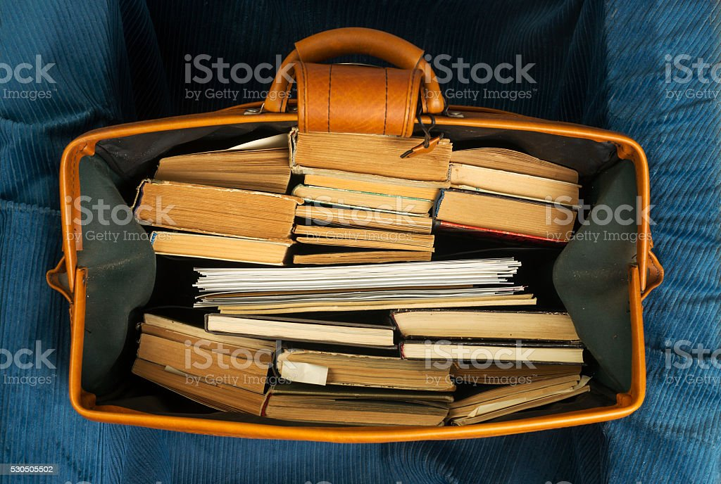 Books in an old suitcase with a retro effect stock photo
