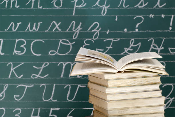 books in front of a blackboard - orthographic symbol stock pictures, royalty-free photos & images