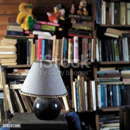 istock Books In Mess On Bookshelves 528291386