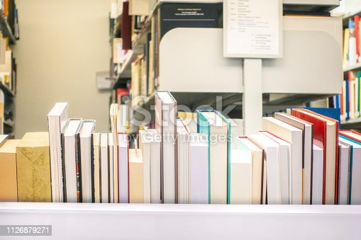 istock Books in the library by the window 1126879271
