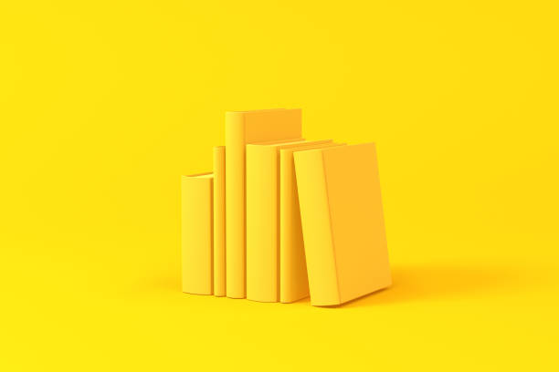 Books isolated over a yellow background. Minimalist concept. stock photo