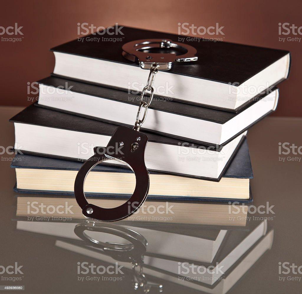 books, law, handcuffs, stock photo