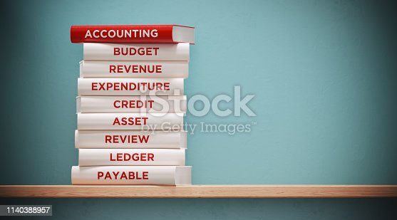 Books of accounting, budget  and expenditure are sitting on top of each other. The books have unique texts on their spines related to accounting  subject.