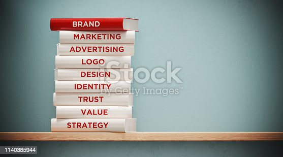 Books of advertising, marketing  and branding are sitting on top of each other. The books have unique texts on their spines related to brand subject.
