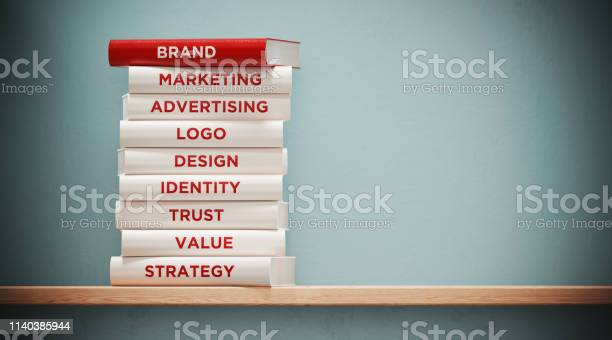 Books of advertising and branding in front grey wall picture id1140385944?b=1&k=6&m=1140385944&s=612x612&h=7qyyez3k t9iynla  m173v mjq2ht s0qw79g6l si=