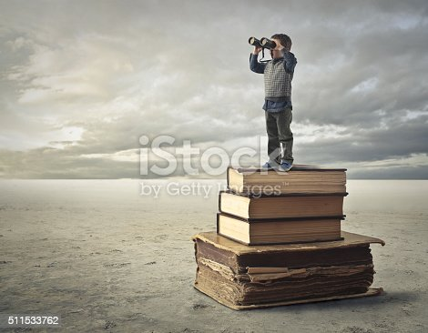 A little is illustrated standing on the books which helps him to see further with his binocular