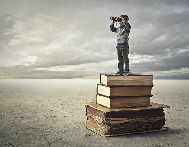 books of knowledge - binocular boy bildbanksfoton och bilder
