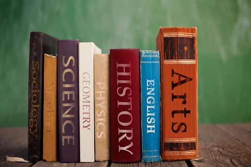 Various class books on wooden table