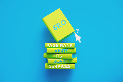 Books of SEO and Ranking Over Blue Background
