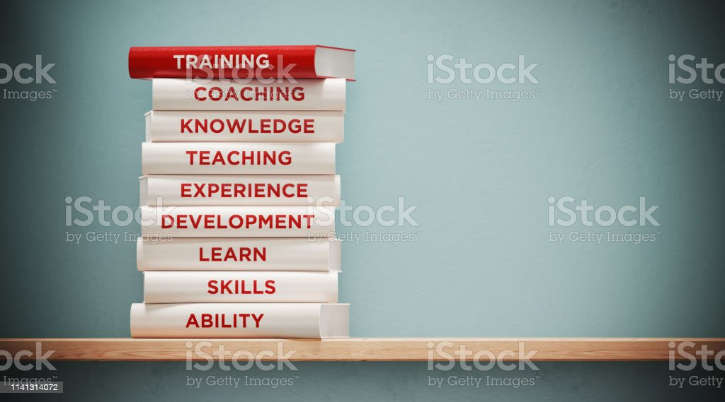 Books of  Training And Development In Front Grey Wall - Стоковые фото Без людей роялти-фри