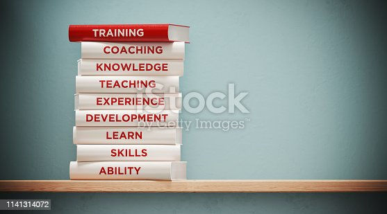 istock Books of  Training And Development In Front Grey Wall 1141314072