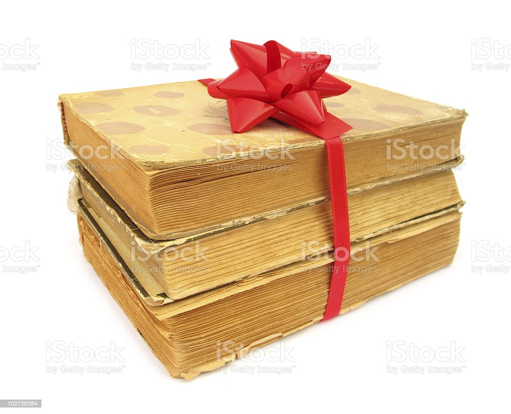 Books old vintage packed as gift with red bow stock photo