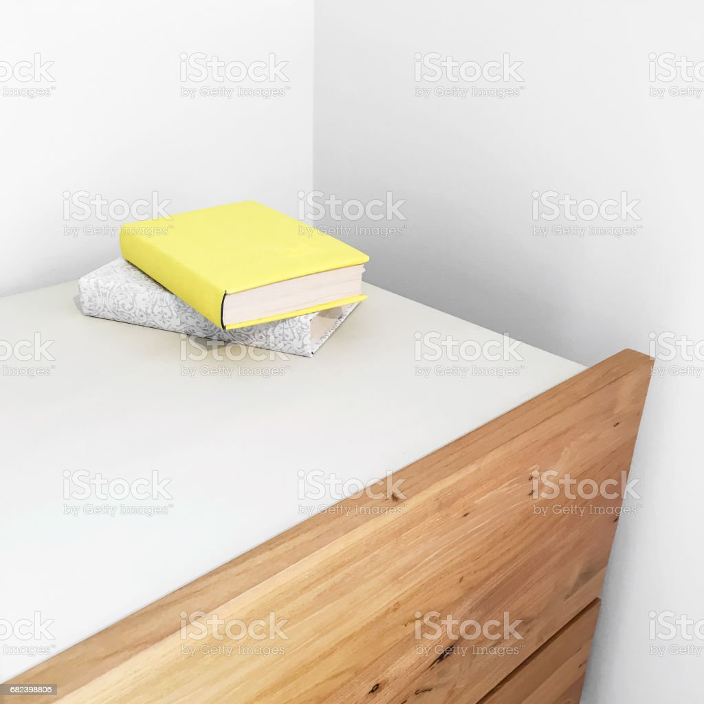 Books on a wooden dresser royalty-free stock photo
