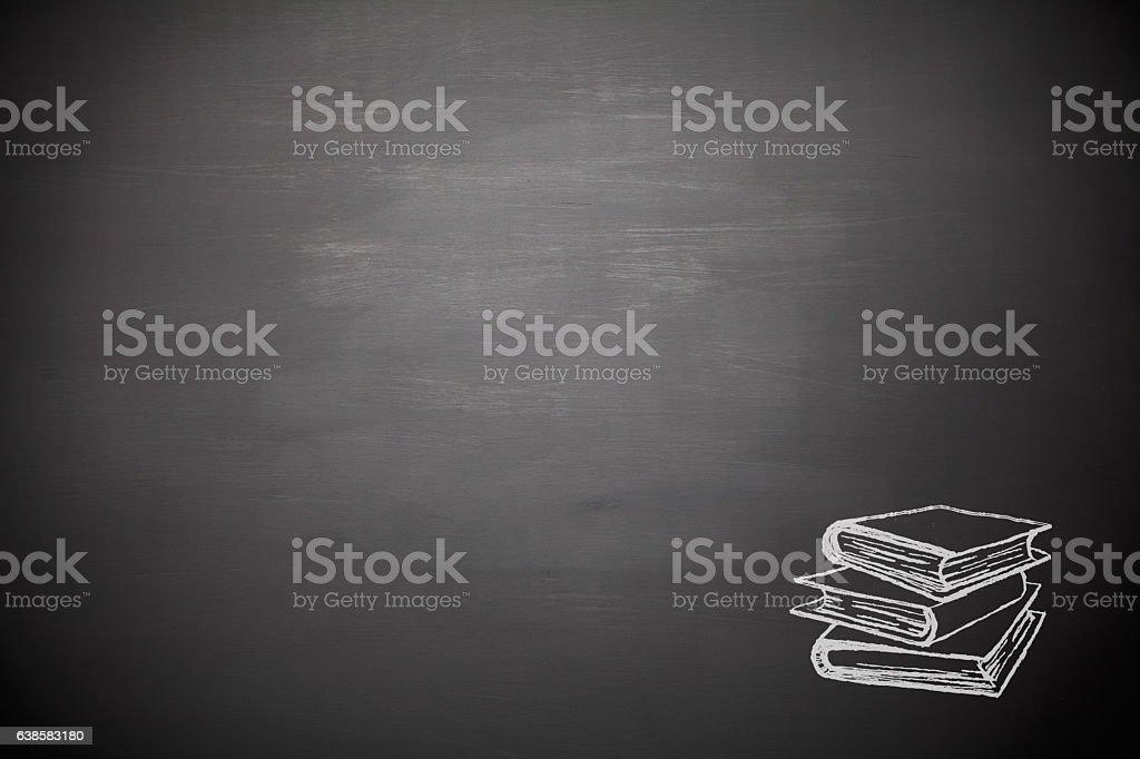 Books on blank blackboard stock photo