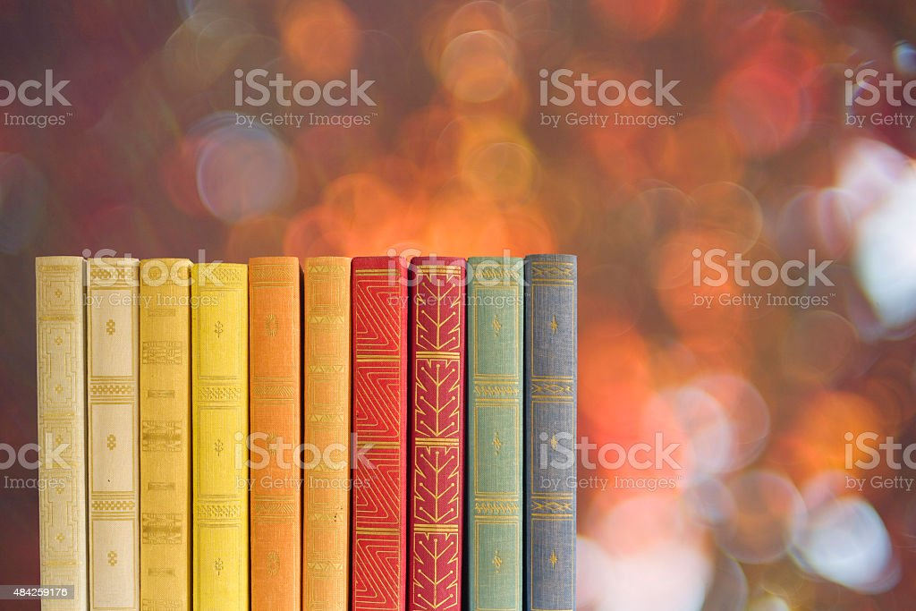 books on blurred nature background, stock photo