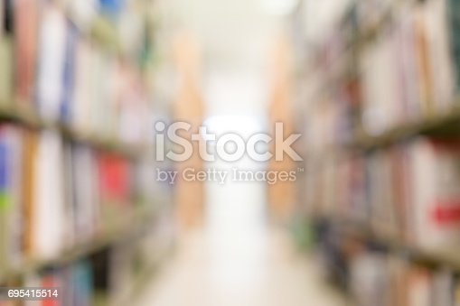 istock books on bookshelf in library, abstract blur defocused background 695415514
