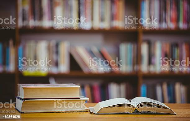 Books On Desk In Library Stock Photo - Download Image Now
